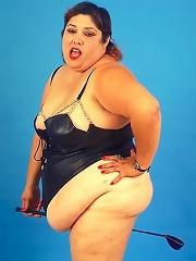 Huge Belly Fat Babe in Dominatrix Look Posing